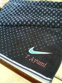 持ち込み頂いたナイキの紺色タオルにネーム刺繍入れの注文。